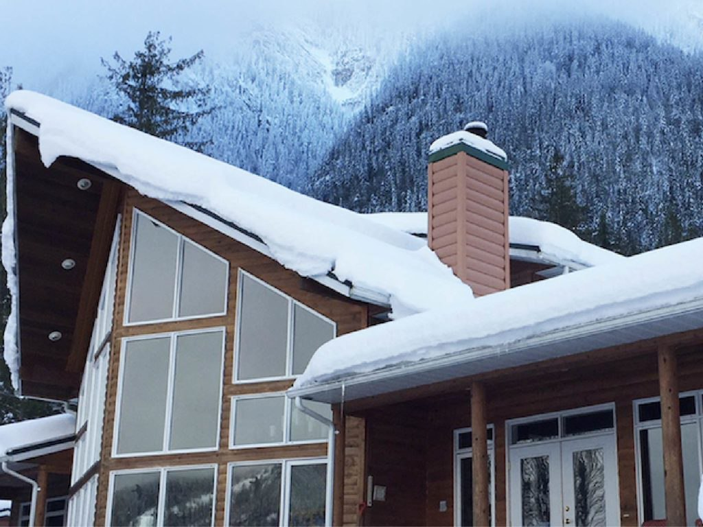 Snow guards for exposed fastened metal roofs