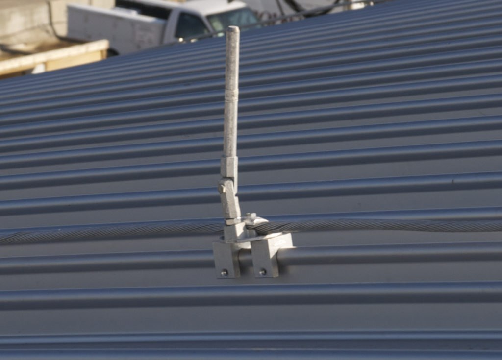 Lightning protection installed on a metal roof S-5 clamps